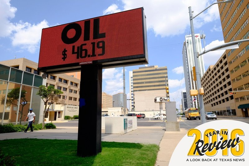A digital sign outside the Chase Bank building in downtown Midland displays the latest per-barrel price of oil.