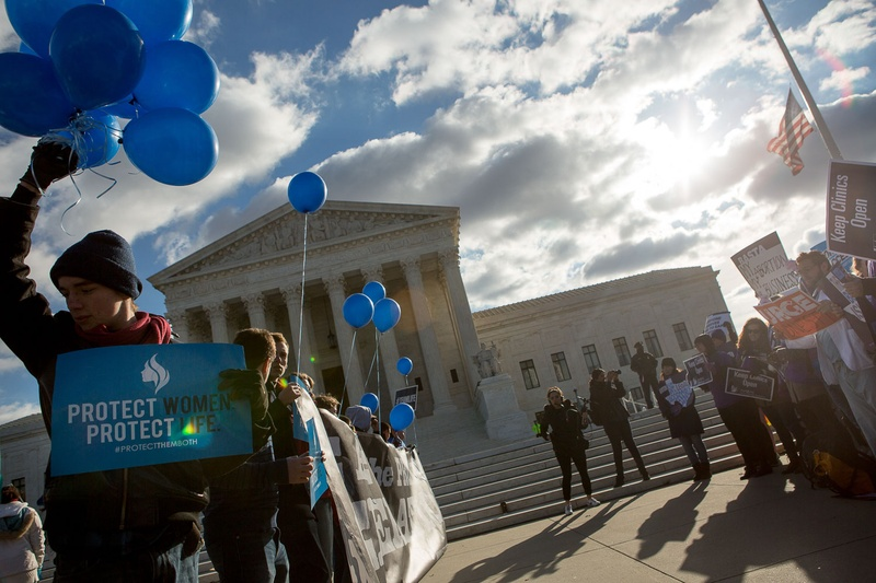 Protesters on both sides of the issue face off in front of the U.S. Supreme Court on Capitol Hill in Washington, D.C. as Whole Woman's Health v. Hellerstedt is argued inside, March 2, 2016. The case is focused on Texas law HB2, which if enforced would result in the closure of more than 75 percent of all women's health clinics that provide abortion services in the state.