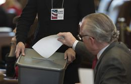 An elector casts his vote for President of the United States during the Electoral College meeting at the Texas Capitol on Dec. 19, 2016.