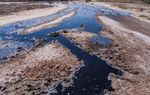 In June of 2016, a thick black substance paints the land around an abandoned well that the Middle Pecos Groundwater Conservation District has asked the Texas Railroad Commission to plug.