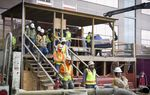 Construction workers take a break for lunch at a construction site for Texas Children's Hospital in Houston on Thursday, December 8, 2016.