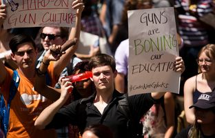 Seis Steves protests the newly enacted campus carry law at the Cocks Not Glocks rally at UT Austin, August 24, 2016.