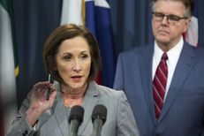 """State Sen. Lois Kolkhorst and Lt. Gov. Dan Patrick unveil the text of Senate Bill 6, which would require transgender people to use bathrooms in public schools, government buildings and universities based on """"biological sex,"""" on Jan. 5, 2017."""
