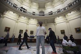 A man preaches in the Capitol rotunda before the start of the 85th Texas Legislature on Jan. 10, 2017