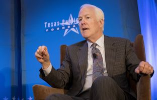 U.S. Sen. John Cornyn talks with Senator Ted Cruz and Brooke Rollins, president and CEO of the Texas Public Policy Foundation, during a TPPF Orientation conference on January 13, 2017 at the Sheraton Hotel in Austin, Texas.