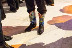 """An attendee sports a pair of self-commissioned """"Make America Great Again"""" boots at the 2017 Black Tie and Boots Ball on the eve of the presidential inauguration of Donald Trump, at the Gaylord National Resort & Convention Center in National Harbor, Maryland, on Jan. 19, 2017."""