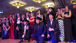 Fans and attendees watch the Lil' Wranglers of College Station, Texas, perform at the 2017 Black Tie & Boots Presidential Inaugural Ball, on the eve of the presidential inauguration of Donald Trump, at the Gaylord National Resort & Convention Center in National Harbor, Maryland, on January 19, 2017.