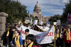 Students, educators, activists and parents march on the south lawn of the Capitol in Austin on January 24, 2017 to show their support for expanding school choice options during National School Choice Week. Gov. Greg Abbott and Lt. Gov. Dan Patrick spoke in favor of expanding school choice options.