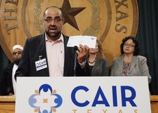 Ahmed Mahmoud of the Austin chapter of the Council on American-Islamic Relations holds up a letter sent by state Rep. Kyle Biedermann, R-Fredericksburg, to poll mosque leaders and Muslim student associations about their beliefs.