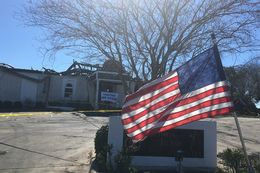 An American flag flies in front of a fire-ravaged mosque in Victoria on Feb. 1, 2017.