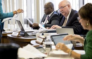 The State Board of Education meets on Feb. 1, 2017 in Austin to discuss biology standards, propose amendments, and vote on them. Lawrence Allen, Jr., Ken Mercer and Barbara Cargill (l-r) look over paperwork during the meeting.