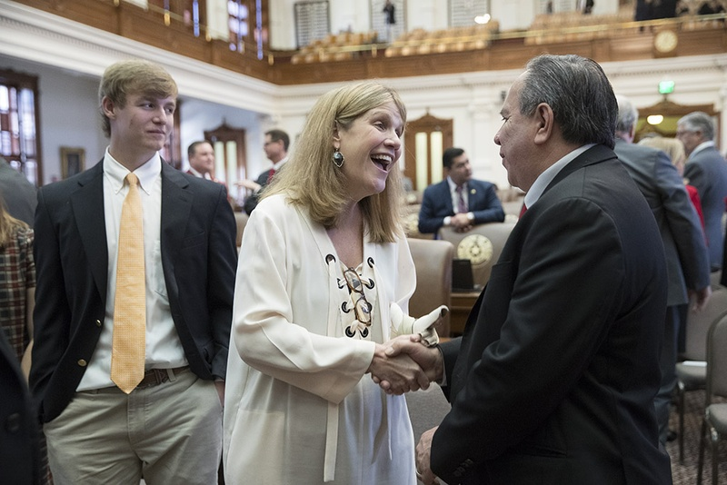 District Judge Julie Kocurek, who was severely injured in a 2015 shooting, greets state Rep. Tomas Uresti after she was mentioned in Chief Justice Nathan Hecht's State of the Judiciary speech on Feb. 1, 2017.