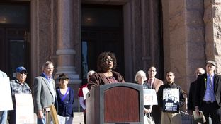 Yolanda White, a board member for the Texas State Employees Union, speaks at a press conference on January 30, 2017 in front of the state Capitol.