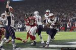 New England Patriots' James White (R) scores a touchdown in the fourth quarter against the Atlanta Falcons at Super Bowl LI in Houston, Texas, U.S., February 5, 2017.