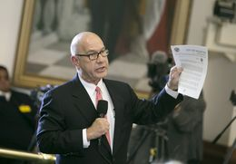 Sen. John Whitmire D-Houston holds up a letter from the city of Houston chief of police as he ask Sen. Charles Perry R-Lubbock questions regarding SB4 on February 7, 2017