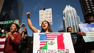 "Klevelin Lion chants at the front of the ""Day Without Immigrants"" march on Congress Avenue, Feb. 16, 2017, in Austin, TX."