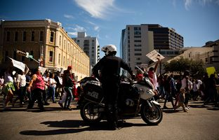 """Austin Police Department set up rolling roadblocks downtown for the """"Day Without Immigrants"""" march on Feb. 16, 2017."""