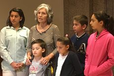 Mercedes Bristol, 62, of San Antonio, at the Capitol with her five grandchildren after testifying to the House Human Services Committee on Feb. 20, 2017.
