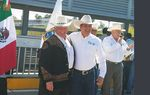 Texas Agriculture Commissioner Sid Miller and Francisco Garcia Cabeza de Vaca, governor of the neighboring Mexican state of Tamaulipas, at the intersection of the Texas-Mexico border on the international bridge spanning the Rio Grande at Laredo on Feb. 23, 2017.