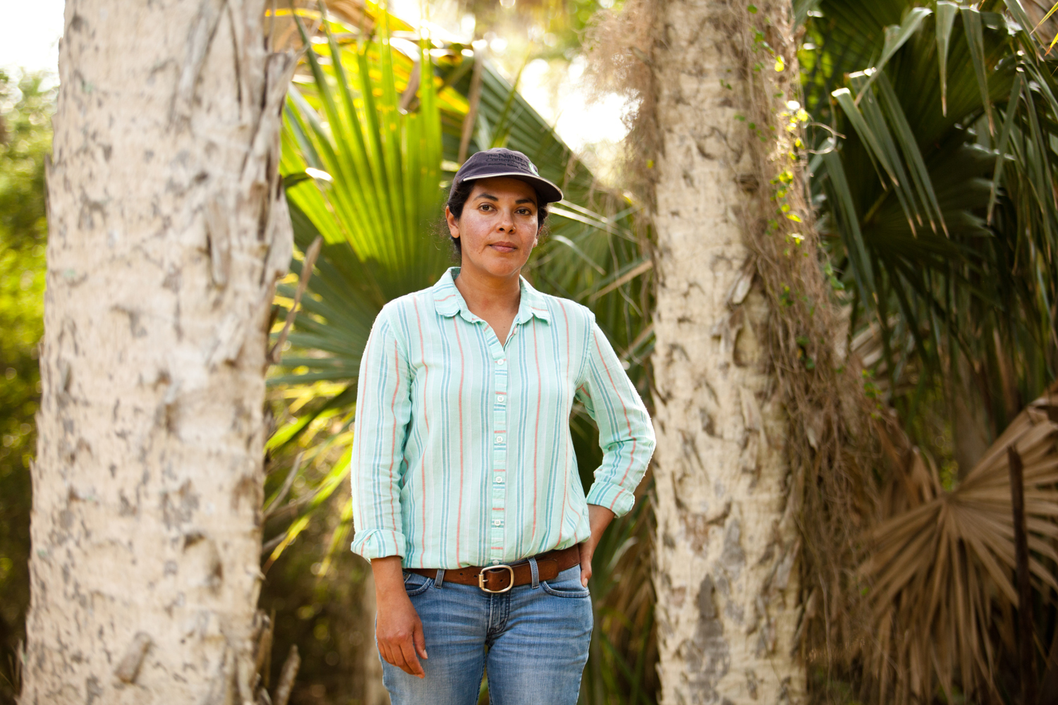 Sonia Najera, grassland manager for the Nature Conservancy, stands in sabal palm forest at the Lennox Foundation Southmost Preserve. The 1,100-acre preserve is home to some of the land remaining patches of sabal palm forest in the United States.It is prime habitat for the endangered ocelot, a small cat that looks like a tiny leopard.