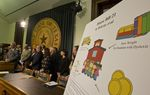 A graphic illustrates some particulars at a press conference unveiling the school finance bill on March 6, 2017.