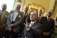 Gov. Greg Abbott discusses the Governor's University Research Initiative grant program at the Governor's Mansion during a reception on March 6, 2017.  Renowned electrical engineering professor Tom Overbye (third from the right), who recently joined Texas A&M University, is shown standing behind Abbott.