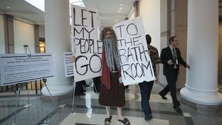 John Erler of Austin poses as Moses in the hallways of the Capitol Extension during public testimony on SB 6 the bathroom bill on March 7, 2017.