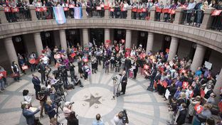 A large crowd of transgender advocates opposed to SB 6 the bathroom bill converge on the Capitol Extension Rotunda during the Senate State Affairs Committee hearing on the bill March 7, 2017.
