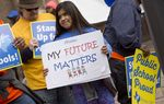 A young girl holds a sign at a rally at a rally held by Texas AFT, the state affiliate of the American Federation of Teachers, on March 13, 2017.