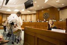 "Joseph Seinsheimer, chairman of the Galveston chapter of the Surfrider Foundation, dressed up as a self-proclaimed ""bag monster"" with dozens of plastic bags wrapped around his upper body. He testified Tuesday against legislation that would would prevent cities from banning plastic bags."