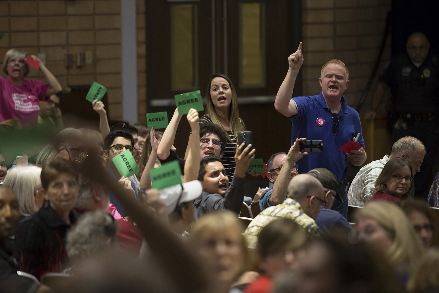 Constituents react at a town hall held by U.S. Rep. John Culberson, R-Houston, on March 25, 2017.