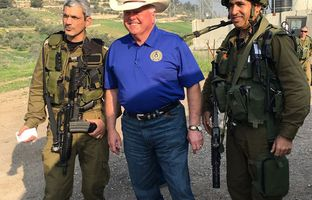 Agriculture Commissioner Sid Miller at an Israeli Defense Forces checkpoint near Hebron with Lt. Col. Dikla Yossi Bar-hen Asherov (l.) and another soldier.
