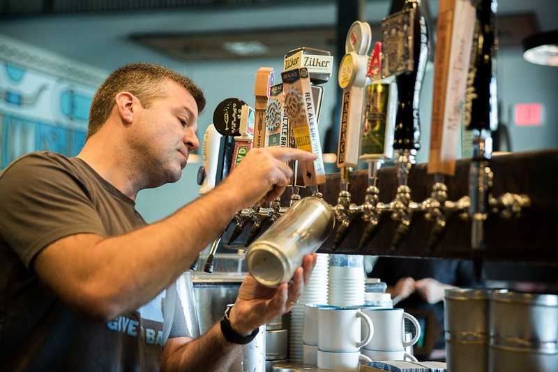 "Mike McKim is on the front lines of state alcohol regulators' attempts to ban ""crowlers,"" or tap beer sold at bars in cans. After more than a year and a half of legal battles, the TABC returned his crowler machine on Thursday and he resumed crowler sales on Friday."