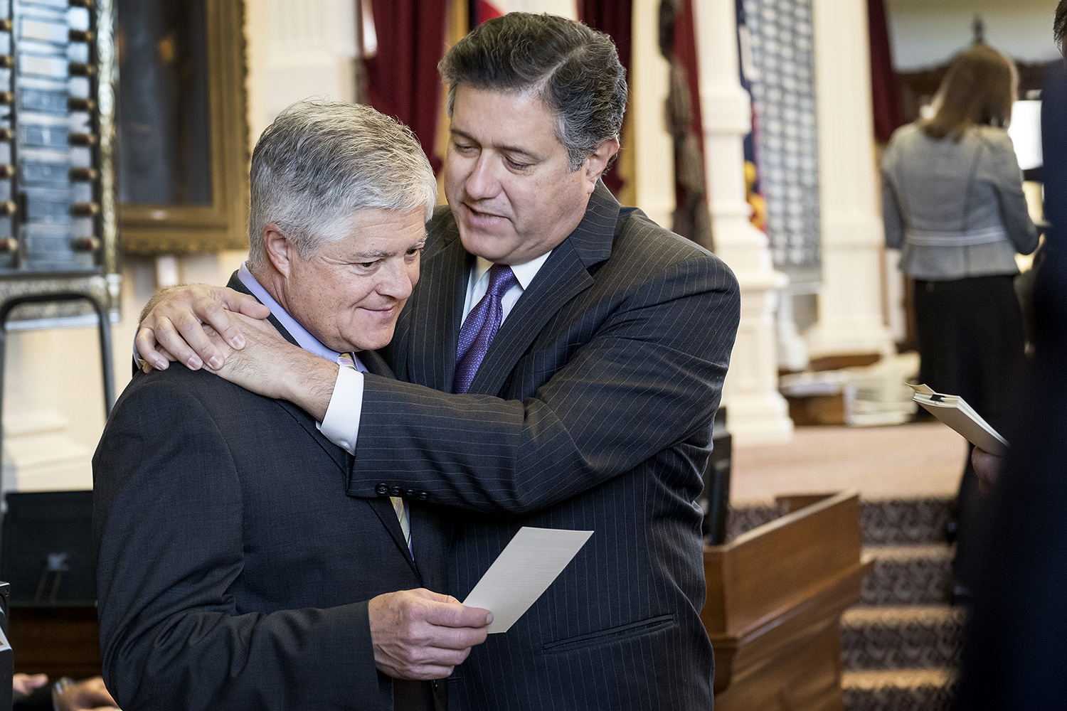 Frullo and Richard Raymond, D-Laredo, huddle on the House floor during the debate.