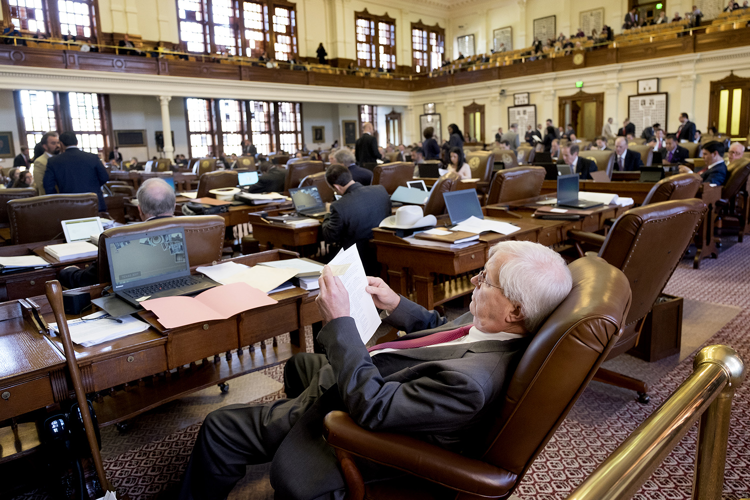 Lawmakers prepared for the anticipated long day in different ways. 20-plus-year House veteran Rep. Charlie Geren, R-Fort Worth, gets comfortable.