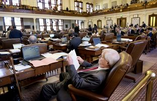 State Rep. Charlie Geren, R-Fort Worth, works from his desk on the House floor during debate on the House budget on April 6, 2017.