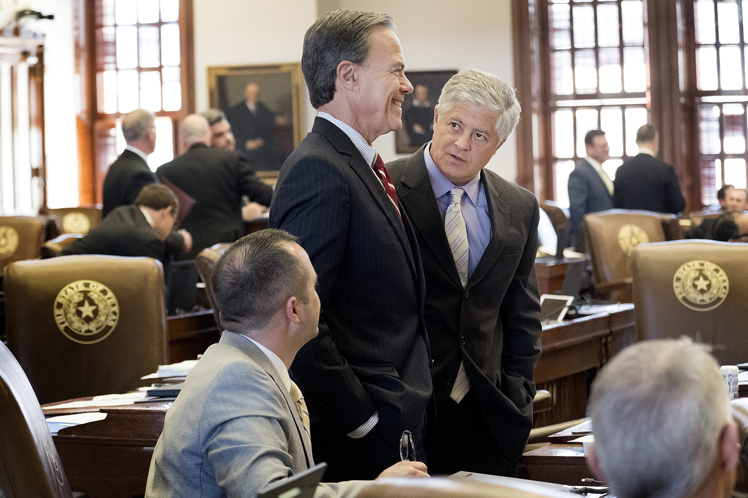 Speaker of the House Joe Straus visits with Rep. John Frullo, R-Lubbock.