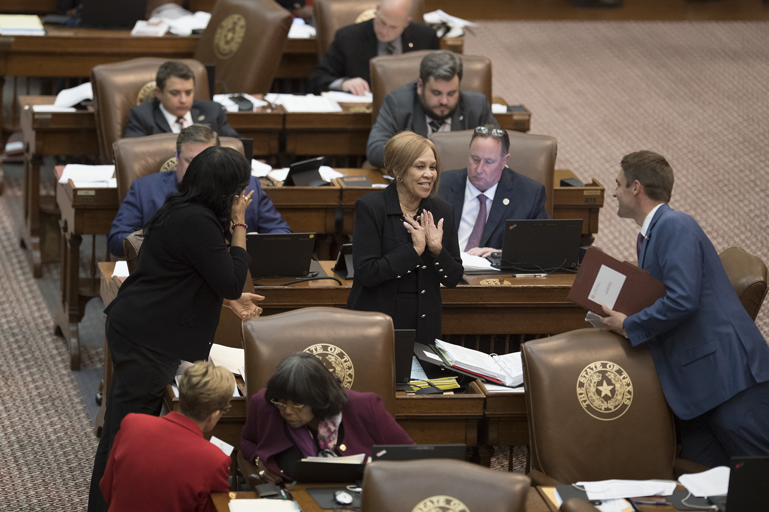 As the night wore on, amendments to the budget arose, passed or failed as the House crafted its final version. Here, Helen Giddings, D-DeSoto, has a light-hearted moment with fellow legislators.