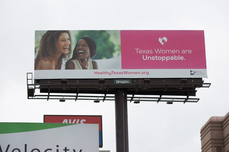 A billboard advertising the Healthy Texas Women program in downtown Austin.