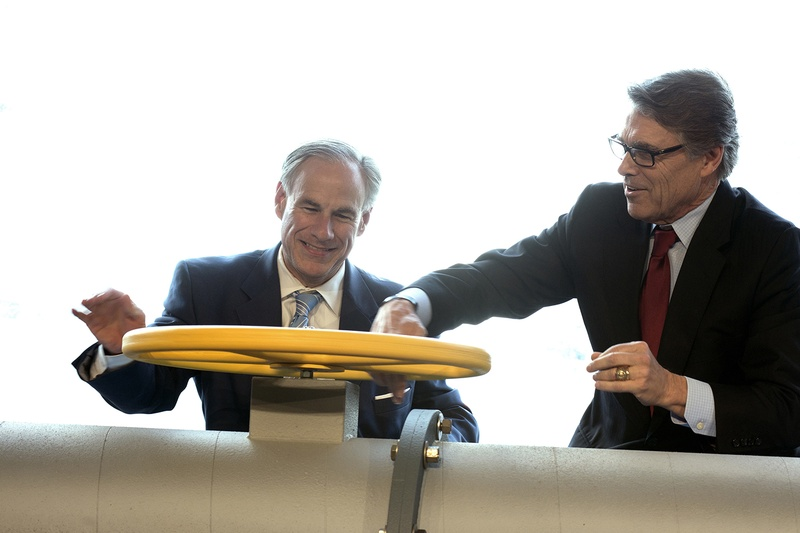 Texas Gov. Greg Abbott, left, and Secretary of Energy Rick Perry join the Petra Nova carbon capture and enhanced oil recovery system partners — NRG Energy, JX Nippon Oil and Gas and Hilcorp Energy — for a ribbon cutting ceremony at the NRG/ Petra Nova Power Plant in Thompsons on April 13, 2017.
