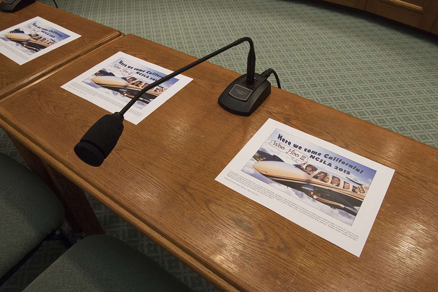 Copies of a flier created internally at the Texas Alcoholic Beverage Commission laid out at the witness table ahead of a hearing held by the House General Investigating & Ethics Committee on April 13, 2017.