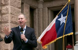 Michael Quinn Sullivan, president and CEO of Empower Texans, speaks during a Tea Party rally on the south steps of the Capitol in Austin on April 17, 2017.
