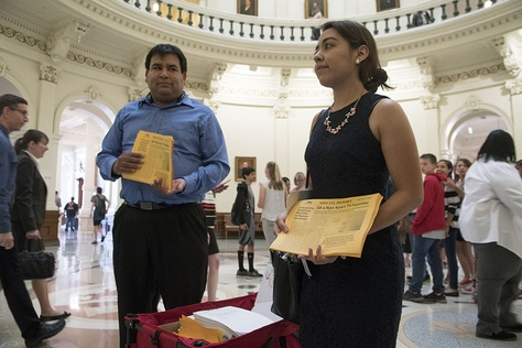 "Daniel Candelaria and Karla Perez of Houston visited the Texas Capitol on April 25, 2017, to express their opposition to Senate Bill 4, which would outlaw ""sanctuary cities."""