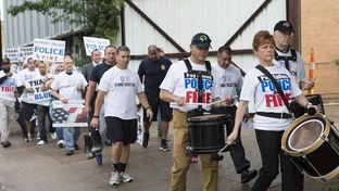 Dallas police officers and firefightersmarch in protest of their failing pension fund in Dallas on April 26, 2017.