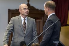 State Rep. Dennis Bonnen, R-Angleton, left, talks with Rep. John Cyrier, R-Lockhart, on the House floor on April 27, 2017.