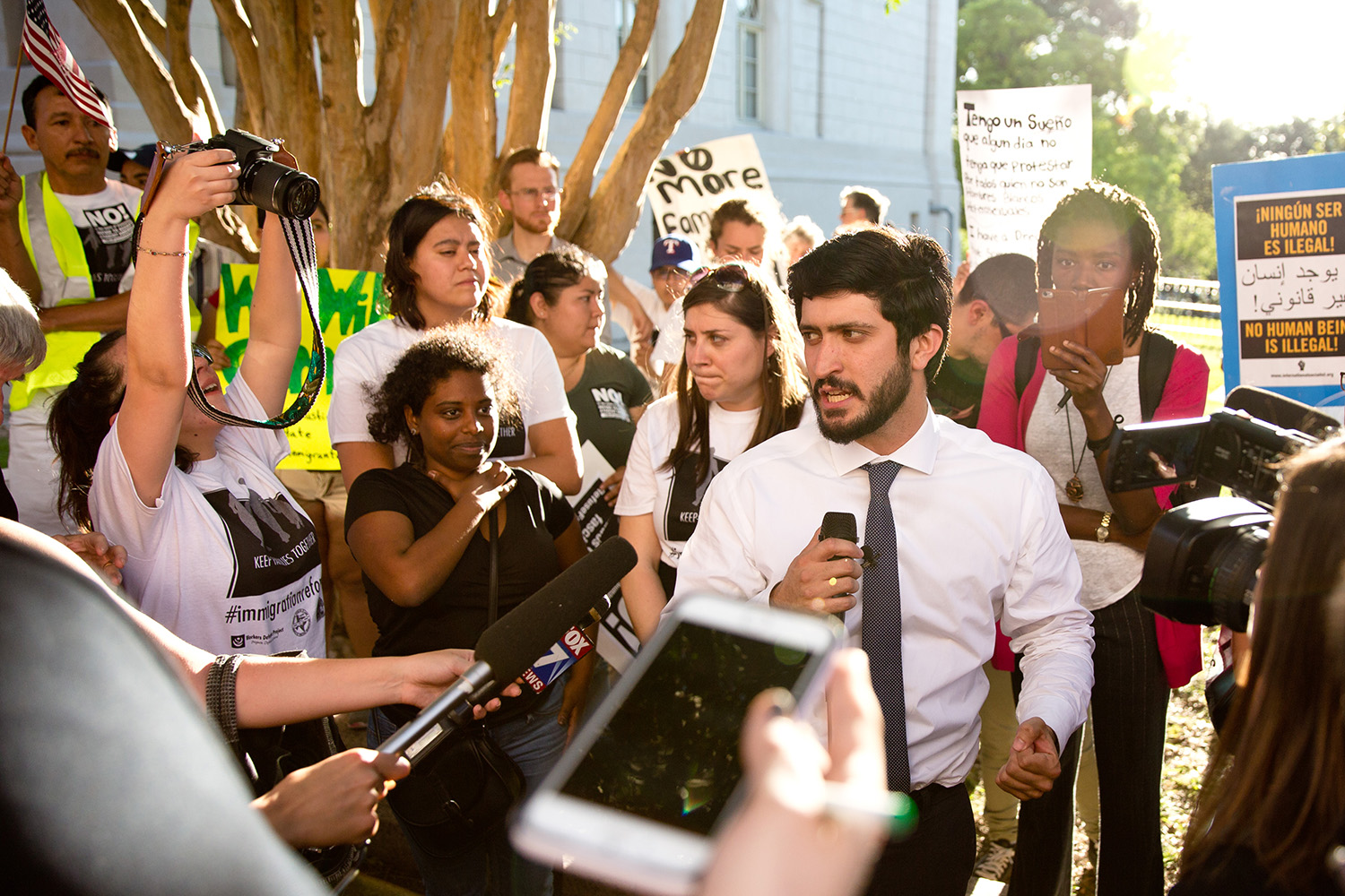 Austin City Council member Gregorio Casar speaks to opponents of the