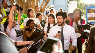 """Austin City Council memberGregorio Casar speaks to opponents of the""""sanctuary"""" jurisdictions bill moving through the Legislature outside the State Insurance Building in Austin on May 1, 2017."""