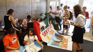 """Opponents of Senate Bill 4 — which wouldoutlaw """"sanctuary"""" jurisdictions in Texas— stage a protest at the State Insurance Building in Austin on May 1, 2017."""