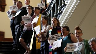 """Members of the clergy and others supporting LGBT rights gather outside the Texas House chamber May 3, 2017 to show support for the community affected by """"bathroom bill"""" legislation pending at the 85th Legislature."""