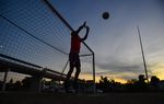 Members of the Twin Cities FC practice at twilight on an Eagle Pass soccer field between the Rio Grande and the current border fence. Piedras Negras, Mexico is in the background.